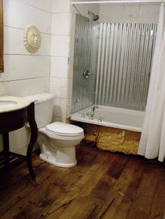 Cottage Dreamers: Pine wood floors in the bathroom - I like the corrugated tub surround as well. Tub Enclosures, Bathroom Shower Walls, Wood Floor Bathroom, Wood Floors, Rustic Bathrooms, Tin Shower Walls, Bathtub Walls, Pine Wood Flooring, Shower Wall