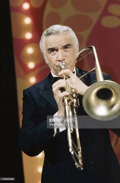Canadian actor and musician Lorne Greene plays the trombone on 'The Dean Martin Show' in February, 1970 in Los Angeles, California. Martin Show, Dean Martin, Lorne Greene, Michael Landon, Trombone, Music Theory, Me Tv, Canadian Artists, My Dad