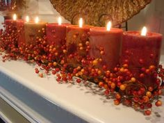 Love the lit fall candles and decor on the mantle.