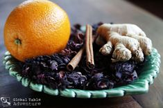 Jamaican Sorrel -2 cups whole, dried hibiscus -2 inches ginger, sliced or chopped -The peel of 1 orange -2 cinnamon sticks -6 cups water -Sugar to taste -Ice to dilute -If you want to spike it add a sweet red wine or rum
