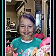 Look at this beautiful princess! She got a fresh new cut for picture day and even got a semi permanent purple in her fringe! So fun!