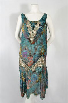 Delightful unidentified vintage dress. The vee is in the pattern. Even see a glimpse of tatting on the hem mimicking the fishnet. Magical. (via inspiration resources blog - also is on Pintarest as Michelle McCormick)