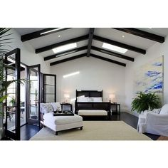 bedrooms - wall glossy black French doors black cane bed ebony box... ❤ liked on Polyvore
