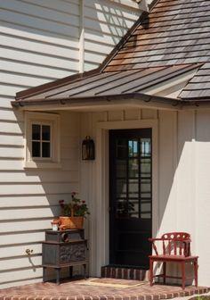 Metal clad flat shed dormer over doorway