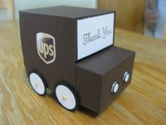 UPS Truck tutorial. Easily made with Simply Scored or Scor Pal, some circle punches, 4 brads and some cardstock.