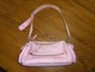Price $14.97 Pretty pink leather Charles David bag with sliver tone hardware and zipper over top to secure bag. There is a pocket on either end of bag...