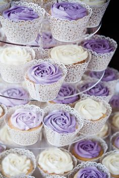 """purple and white frosting on these """"rose"""" cupcakes"""