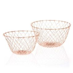 Bahne Set Of 2 Round Copper Wire Baskets: The Set of 2 Round Copper Wire Baskets from Bahne are perfect for general home storage uses! Ideal for storing household items, toys, clothes, shoes, towels and any other similar items in style. The weaved wire in a trendy copper colour has a hand-weaved finish, giving the baskets a traditional and rustic vibe.