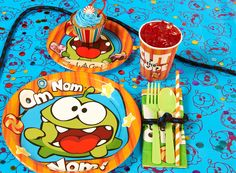 Cut the Rope party! Table setting. #cuttherope #omnom #BirthdayExpress