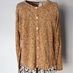 Two piece sweater and tank set. Sparkly. Bottom front sweater and tank top set . Sparkly  animal print look. Tag says dry clean. Very nice condition for wear. Liz Claiborne Sweaters Cardigans