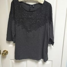 Avenue gray 3/4 sleeve tee Charcoal gray, 3/4 sleeve tee shirt with lace like screen printed flowers, accented with silver beads.  100% lightweight cotton. Perfect condition. Avenue Tops Tees - Long Sleeve