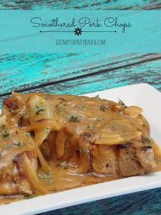 Smothered Pork Chops - seasoned pork chops smothered in a flavorful onion gravy! Yum-o Pork Recipes, Cooking Recipes, Cooking Ideas, Crockpot Recipes, Pork Ham, Baked Pork, Boneless Pork Chops, Chops Recipe, Pork Dishes