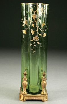 """A MOSER GREEN GLASS VASE circa 1900 decorated with a cascading gold branch, attached to a 4 pillar gilt bronze foot. Height 11"""""""