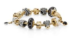 Bold and dramatic in gold and black! @Alexandra Krasnova bracelets and charms are available @MontSe SotRes Jewelers