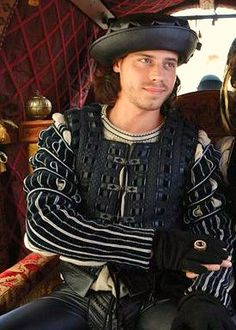 The Sheriff in a friendly mood (which would never happen.) @Corinne Everdeen I think I found a Sheriff sort-of lookalike, what do you think? (Francois Arnaud as Cesare - The Borgias)