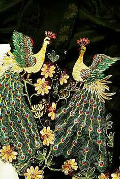 A richly detailed peacock motif on a nyonya kebaya (embroidery art from Penang in Malaysia).