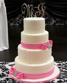 pink and brooch wedding cake