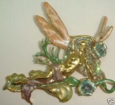 THIS IS A MOST LOVELY AND SWEET PIECE FROM KIRKS FOLLY............THIS MYSTICAL FAIRY - ANGEL HAS THOSE DAZZLING OVERSIZED WINGS THAT KIRKS IS SO FAMOUS FOR......HER GARMENT IS A LIGHT SHIMMERY LAVENDER.........THIS WONDERFUL PIECE MEASURES 3 AND 1/4 INCHES TALL .......BEAUTIFUL PIECE WITH A SPRINKLING OF MAGICAL PIXIE DUST........MORE KIRKS IN THE STORE