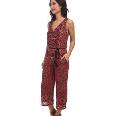 Free People jumpsuit Free People jumpsuit with keyhole back and rope belt. Price is firm. Free People Pants Jumpsuits & Rompers