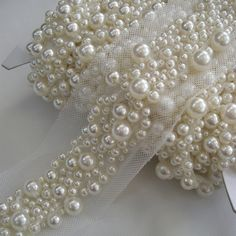pearls for embroidery on wedding dress. on neckline, scattered down wait and back and down train. Pearl Embroidery, Tambour Embroidery, Couture Embroidery, Embroidery Fashion, Embroidery Patterns, Hand Embroidery, Bordados Tambour, Tambour Beading, Bridal Sash Belt