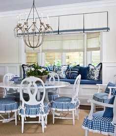 A pillow-packed window seat provides extra seating when the dining table is full -- or just a cozy spot to curl up with a book. The dining room& blue-and-white scheme carries over from room to room in the waterside residence. Blue Rooms, White Rooms, Küchen Design, Interior Design, Design Ideas, Ideas Hogar, Waterfront Homes, White Houses, White Decor