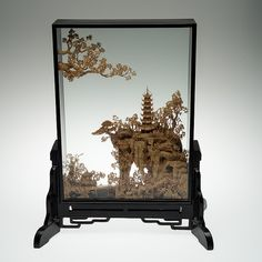 DIORAMA with a wood and cork carving of a chinese landscape, China 20th century.