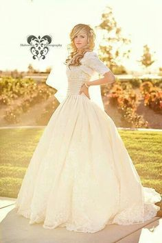 This Dresses Ball Gown skirt is angelic in the way that it falls. The Ribbon waist also compliments the dress.