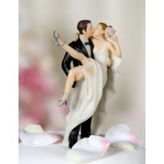 This website has TONS of cool wedding cake toppers! This one's just so adorable.