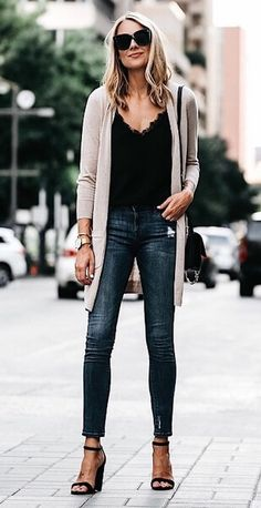 A long cardigan in a soft blush shade is the ideal way to add some texture and warmth to an everyday outfit of jeans and a camisole. #winteroutfits #winter #outfits