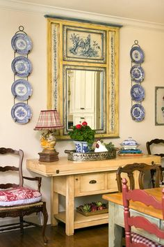 French country dining room with blue and cream trumeau mirror and blue and white transferware plates -- home owners: Nancy and Charles Vines -- photo: Nancy Nolan French Country Dining Room, French Country Cottage, French Country Style, Country Blue, Rustic French, Country Farmhouse, Southern Style, French Decor, French Country Decorating