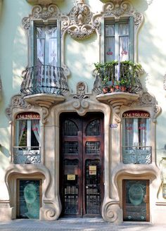 From Spain (perhaps Barcelona? Gorgeous stone facade with Art Nouveau swirls and a bit of Gaudi inspiration. MAISON de BALLARD: When One Door Closes. Beautiful Doors From Around the World Architecture Art Nouveau, Beautiful Architecture, Beautiful Buildings, Architecture Details, Barcelona Architecture, Spanish Architecture, Parisian Architecture, Cultural Architecture, Architecture Interiors