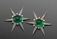 Pair of Emerald Cabochon and Diamond Star Pins by Kern. Mid 20th century