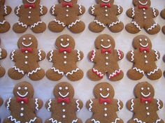Christmas gingerbread men with nifty red bow ties and happy smiles.