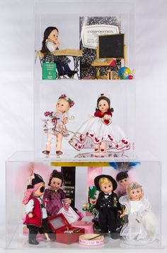 """Lot 655: Madame Alexander Mardi Gras, School, and Valentine 8"""" Doll Display Assortment; Including three display cases, eight dolls, MADCC convention ribbons and accessories"""