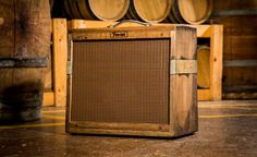 "Fender Whiskey Barrel Amps // A bottle of whiskey was the post-show beverage of choice for so many legendary rock bands. Fender is bringing the two worlds together again with the release of their limited edition ""80 Proof"" Blues Junior amplifier. The cabinet for the amp is crafted from used whiskey barrels, and no two are alike. Packed inside the booze-soaked case is 15 watts of all-tube power, reverb, and an upgrade 12″ 8-ohm Jensen P12Q speaker. Only 100 will be made—60 of which will be sold at select retailers in the States—so if you want your musical setup to include a bit of whiskey history, you'd best snag one before they're gone for good. 