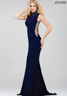 Style#: 36087  Sexy sleeveless form fitting dress features lace up side details and crystal adornments www.oneenchantedeveningonline.com