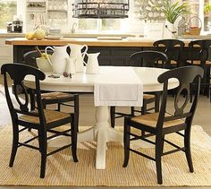 Crushing on white pedestal tables right now, like this one from Pottery Barn.