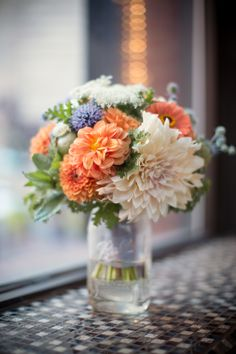 Bridal bouquet. Late July wedding. Local zinnias, dahlias, poppy pods, thistle, ammi, scented geranium. Dumbo Loft. Brooklyn, NY. Photo Credit: Weddings By Two