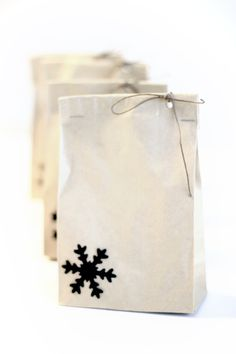 White bag, black snowflake, punch out a hole tie with string