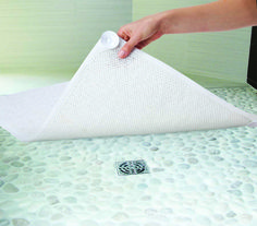 Exfoliate your feet with each shower! Just place this non-slip mat onto the floor of your bathtub or shower stall. Rub your feet over its textured surface to uncover smooth, radiant skin. Place it right over the drain - water and suds to flow right through holes on the mat. Quick drying and mildew resistant.  • Soft and comfortable • Prevents slipping • Mildew resistant • Water & suds flow through • Quick drying • Long lasting • Acts as a loofa!