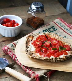 Bruschetta style pita pizzas ~~~~~~~~~ A bruschetta-like topping on healthy whole wheat pitas makes for a delicious, budget-friendly, and low-calorie meal.