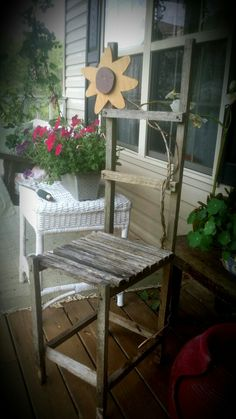 My Primitive old tobacco stick chair on my porch.  Kris