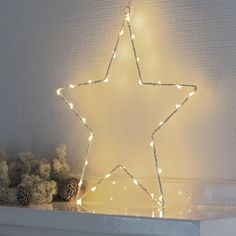 This simple and elegant small Liva fairy light star by Sirius, is made up of 40 warm and soft LED lights securely wrapped around a white metal star Xmas Lights, Fairy Lights, Wall Lights, Hanging Star Light, Star Diy, Battery Operated Lights, Shops, Metal Stars, Christmas Mood
