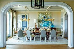 An abstract painting by Ross Bleckner enlivens the dining room.