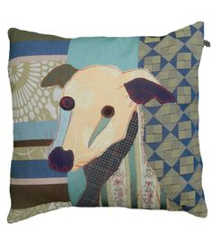 Flash the Whippet cushion, made with a combination of vintage and upholstery fabrics. The dog is made out of precise cut out bits of fabric to create its character, and topstitched in red. Includes 40 x40 cm feather pad.