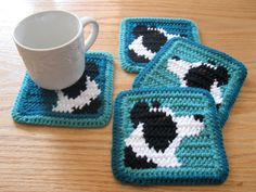 Border Collie Dog Coasters. Teal and jade, crochet coaster set with black and white collies.