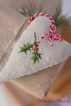 heart cross stitch ornament: holly twig with berries and snowing