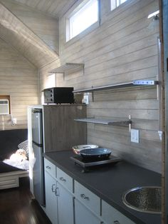 I like how it's modern and rustic... beachy almost with the color of the wood.  Nice.