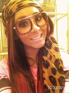 Snooki. love the head wrap and nerdy sunglasses once again making you look sexy n fun :p