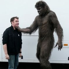 On the right is Benicio Del Toro as The Wolfman
